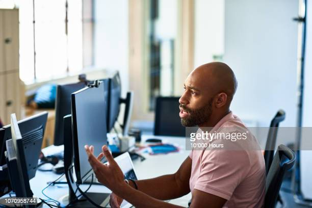 serious businessman with beard at desk explaining - complaining stock pictures, royalty-free photos & images