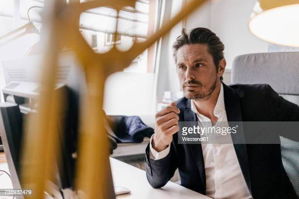 Serious businessman working at desk
