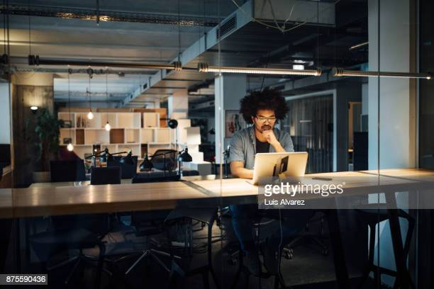 serious businessman working on laptop - concentration stock pictures, royalty-free photos & images
