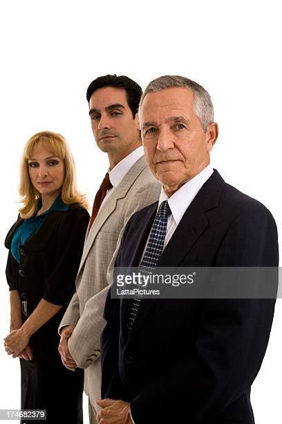 Serious businesswoman and two businessmen in a row