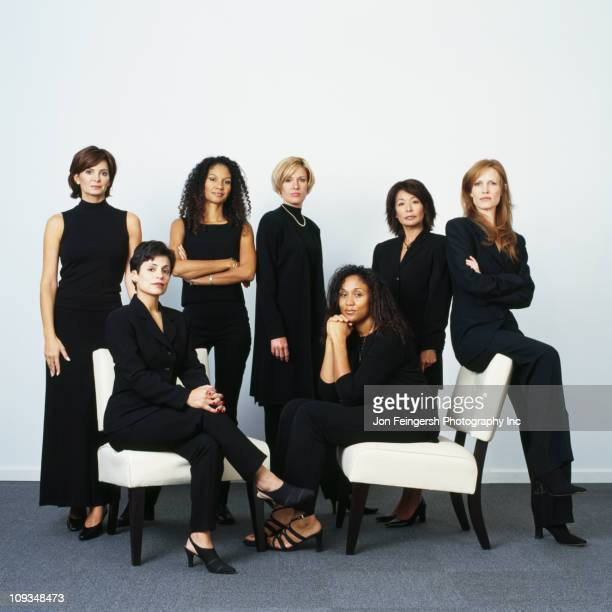 serious businesswomen dressed in black - medium group of people stock pictures, royalty-free photos & images