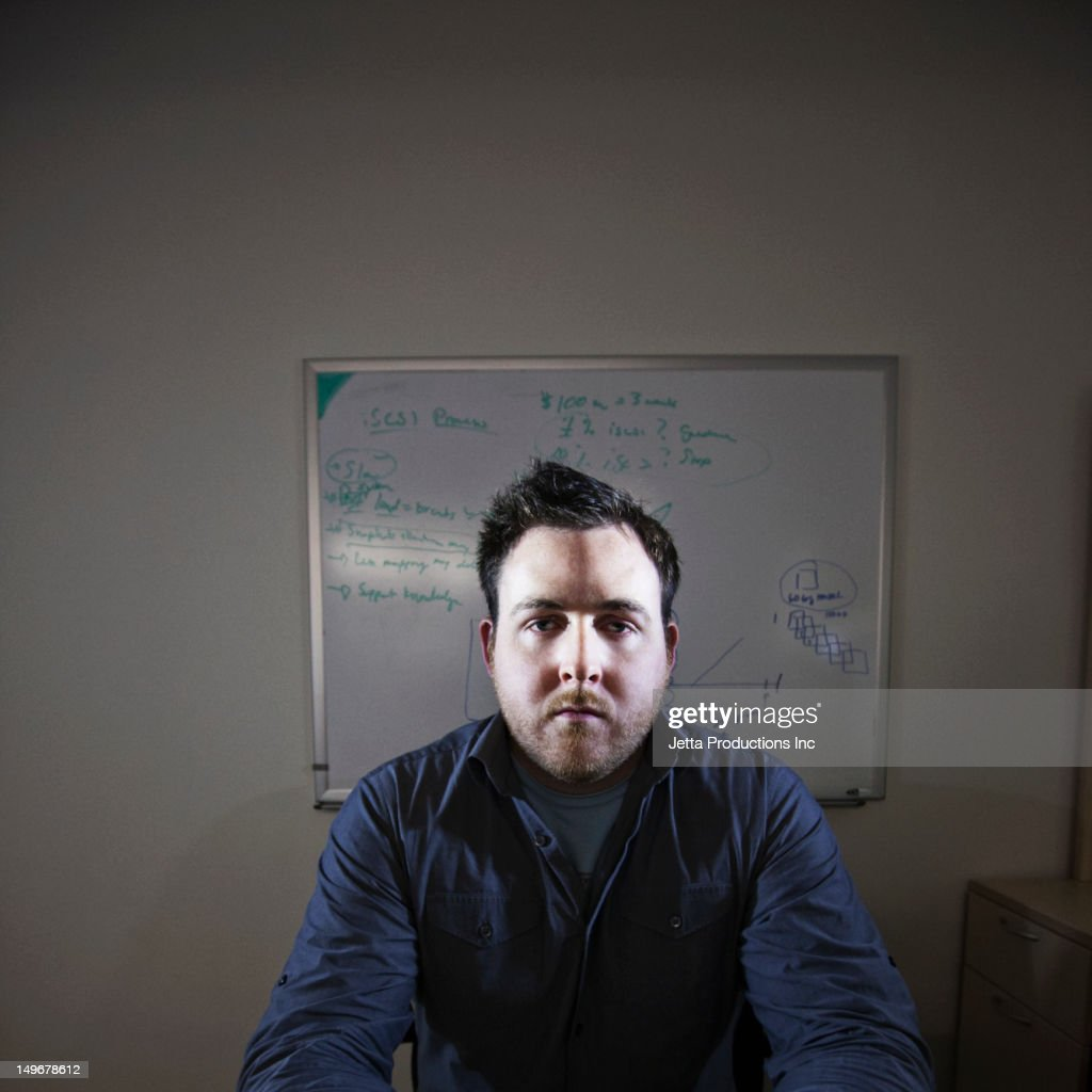 Serious Caucasian businessman in office : Stock Photo