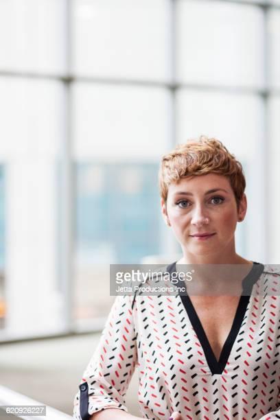 Serious Caucasian businesswoman in office