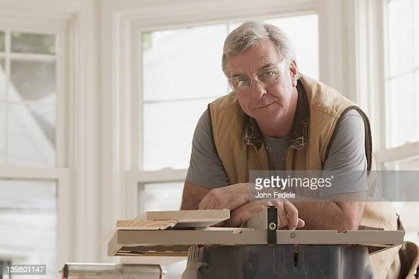 serious caucasian carpenter - protective eyewear stock photos and pictures