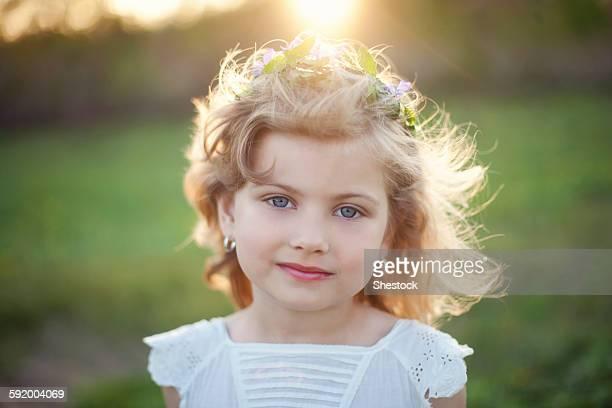 Serious Caucasian girl outdoors