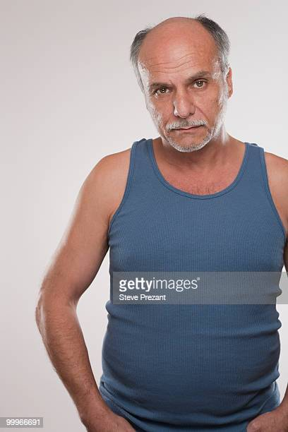 Serious Caucasian man in muscle-t