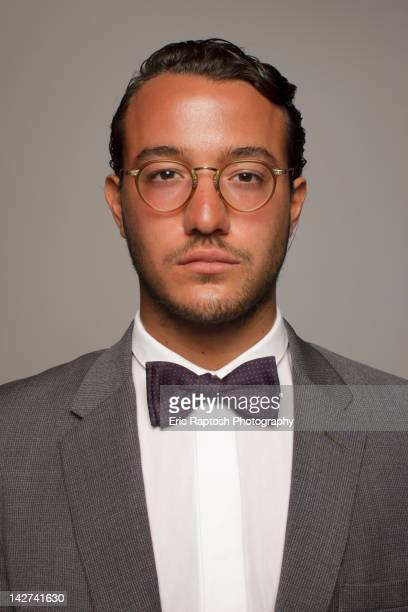 Serious Caucasian man in suit and bow tie