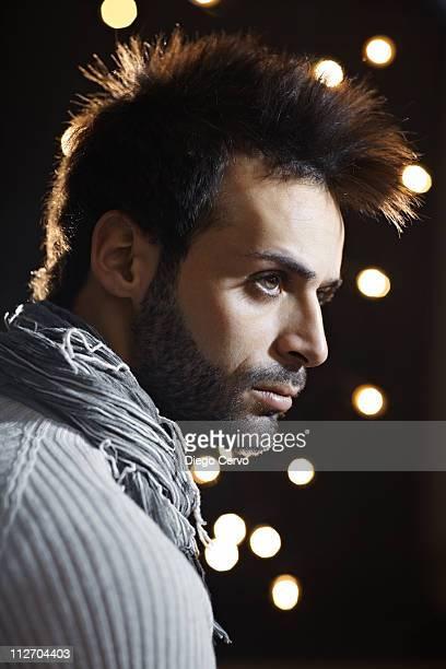 Serious Caucasian man with beard at night