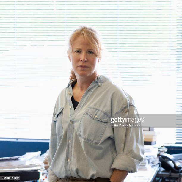 Serious Caucasian woman in office
