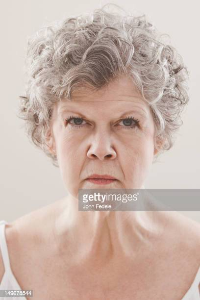 serious caucasian woman - frowning stock pictures, royalty-free photos & images