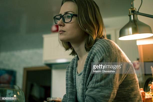 Serious Caucasian woman sitting indoors