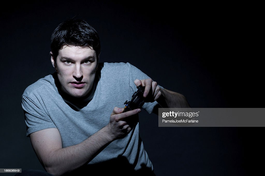 Serious Caucasian Young Man Playing Video Games : Stock Photo