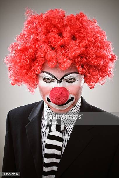 serious clown narrowing eyes - scary clown makeup stock photos and pictures