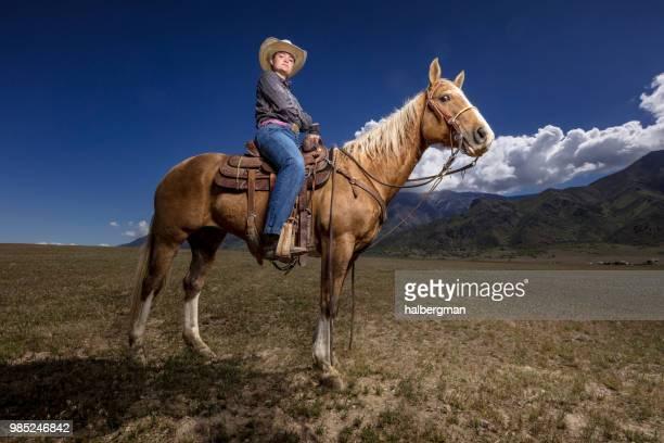 Serious Cowgirl on Horseback