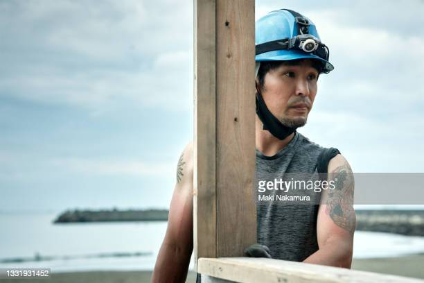 a serious craftsman gazes at something. - chigasaki stock pictures, royalty-free photos & images