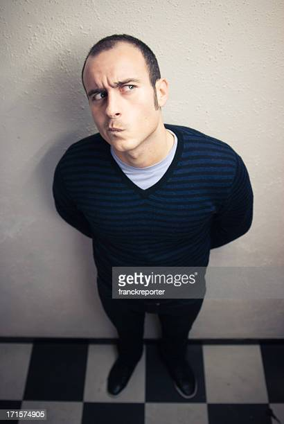 serious curious man - male feet on face stock photos and pictures