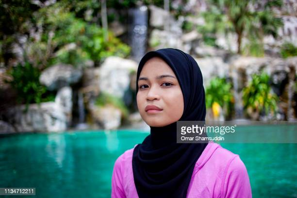 Serious face portrait of sport Asian woman with hijab