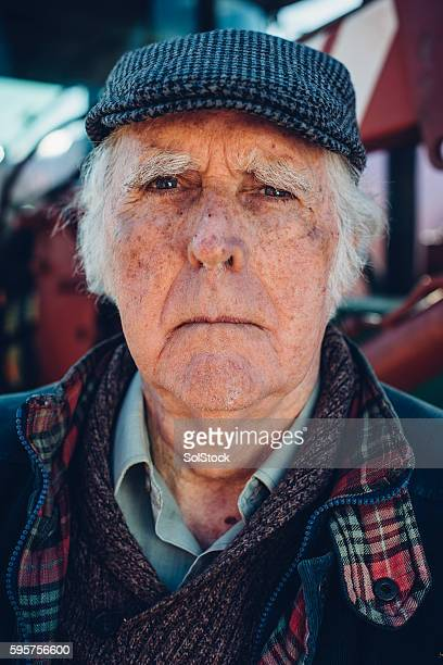 serious farmer - flat cap stock photos and pictures