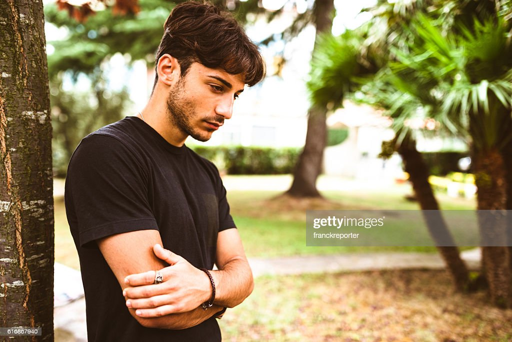 Serious fashion man portrait in the nature : Stock Photo