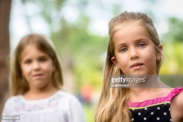 Serious girls at a park