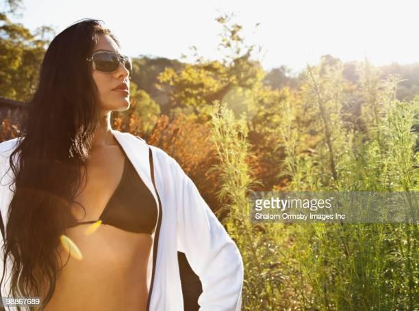 Serious Hispanic woman in bikini