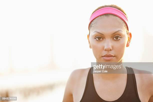 Serious Hispanic woman wearing headband