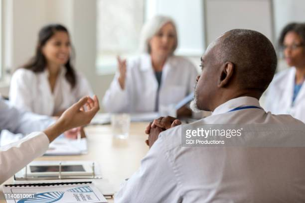 serious hospital administrator - debate stock pictures, royalty-free photos & images