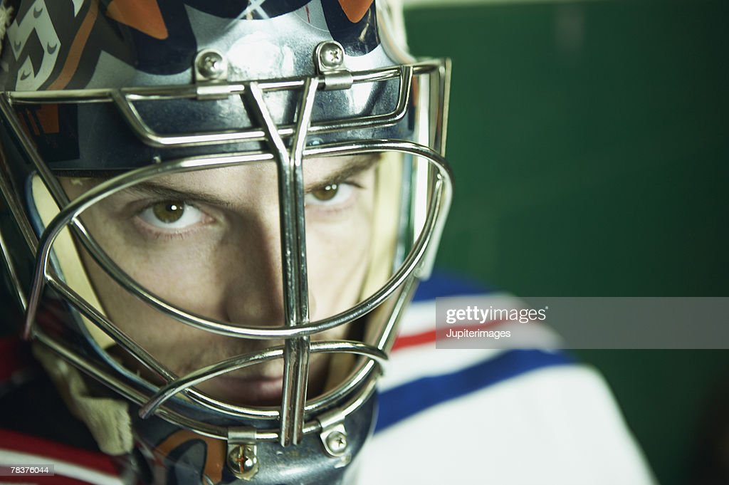 Serious ice hockey player : Stock Photo
