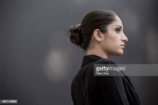 Serious Indian woman looking away