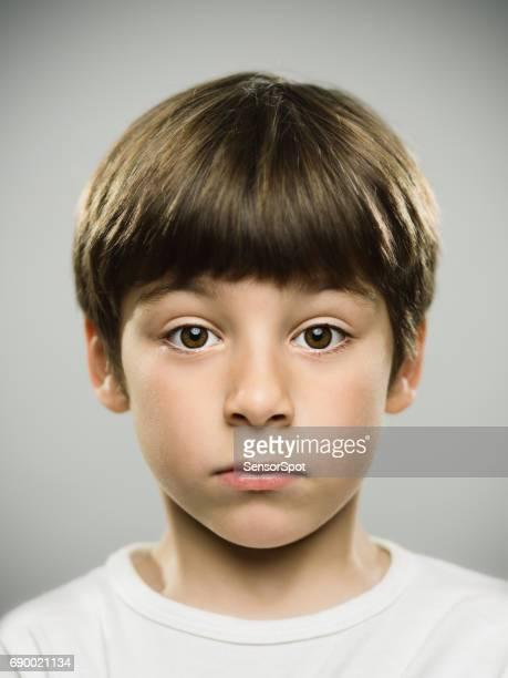 Serious kid looking at camera