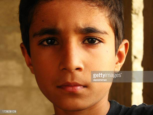 serious kid - cute pakistani boys stock photos and pictures