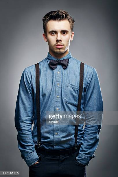 serious man looking at camera - suspenders stock pictures, royalty-free photos & images