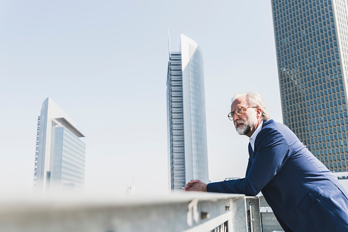 Serious mature businessman in the city looking around - gettyimageskorea