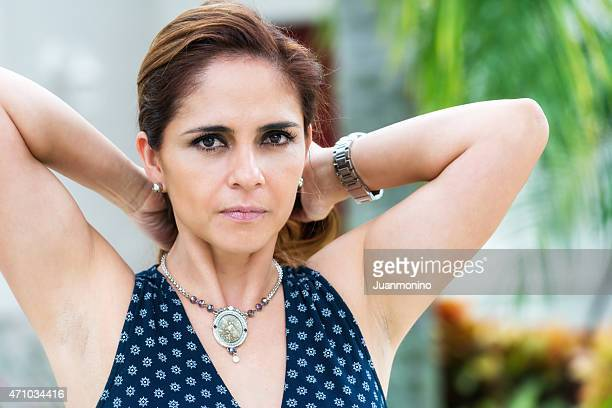 serious mature hispanic woman - female armpits stock pictures, royalty-free photos & images