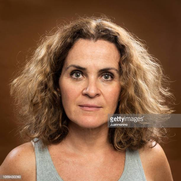 serious mature woman (no make up) - no make up stock pictures, royalty-free photos & images