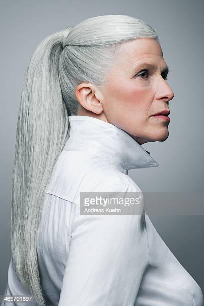 serious mature woman with long, grey ponytail.