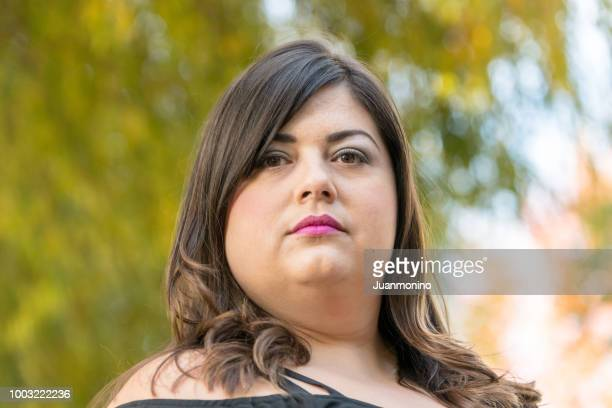 serious mid adult woman looking at the camera - southern european descent stock pictures, royalty-free photos & images