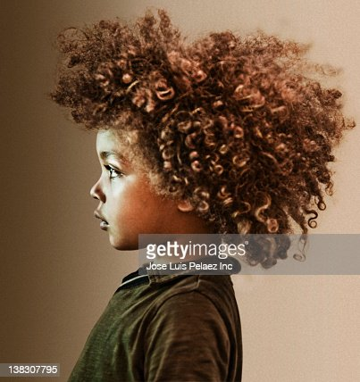 serious mixed race boy with curly hair highres stock