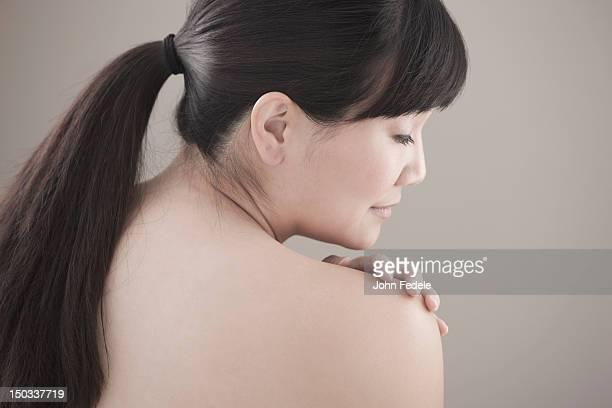 serious, nude asian woman - medelålders kvinnor naken bildbanksfoton och bilder