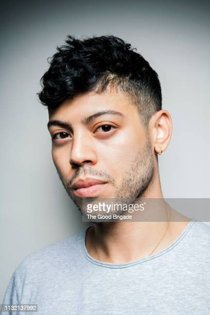 serious portrait of a serious young man in studio - hair stubble stock pictures, royalty-free photos & images