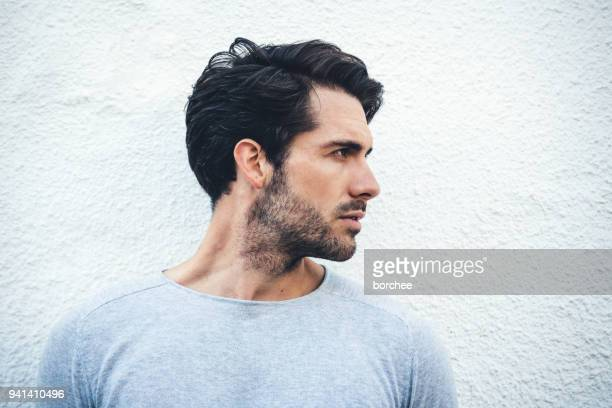 serious portrait of a young man from spain - side view stock pictures, royalty-free photos & images