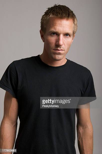 Serious Portrait of Young Man in Black T-Shirt