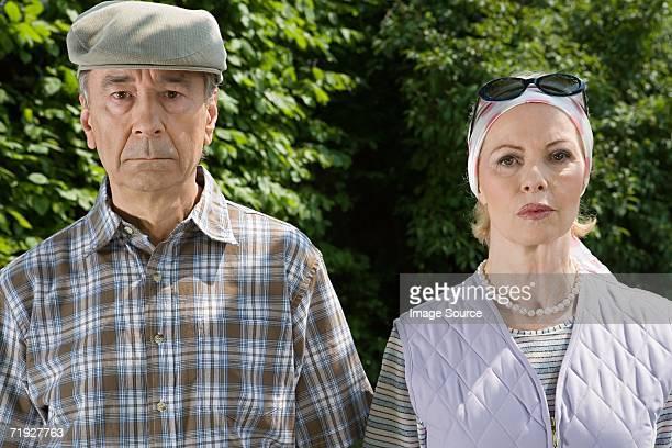 Serious senior couple