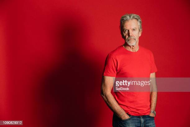 serious senior man - t shirt stock pictures, royalty-free photos & images