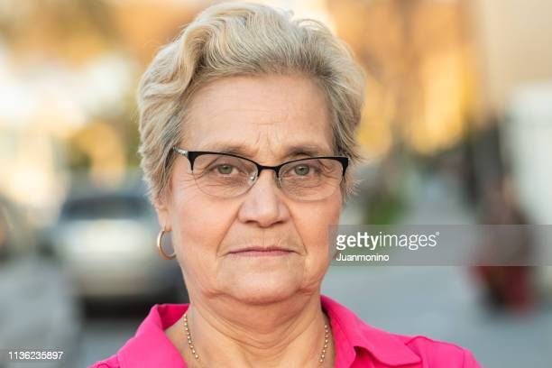 serious senior woman looking at the camera - minority groups stock pictures, royalty-free photos & images