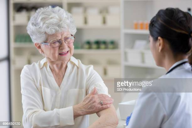 Serious senior woman makes a face after receiving vaccine