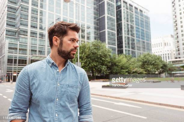 serious smart casual man in canary wharf - stubble stock pictures, royalty-free photos & images