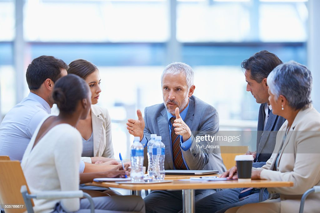 Serious strategising : Stock Photo