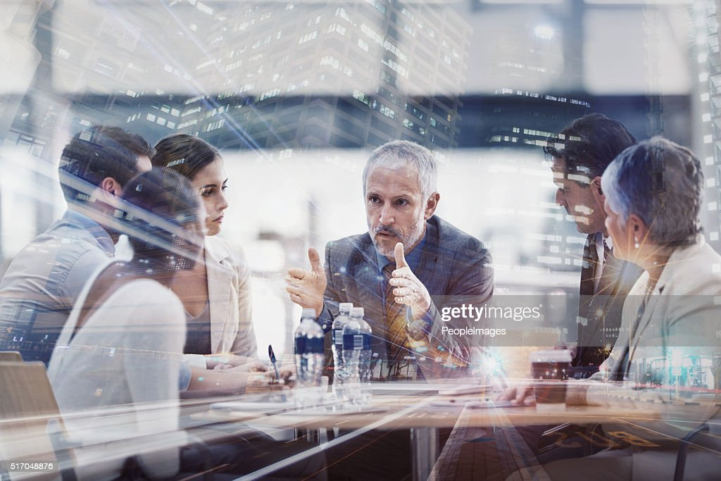 Serious strategizing into the evening : Stock Photo