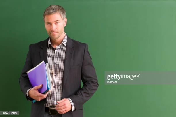 serious teacher at blackboard